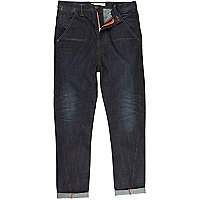 Dark wash denim twist seam jeans