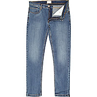 Mid wash denim Flynn skinny jeans