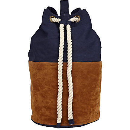 Navy and tan suede duffle bag
