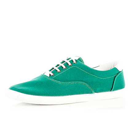 Green lace up plimsolls