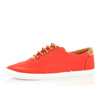 Red and tan contrast plimsolls