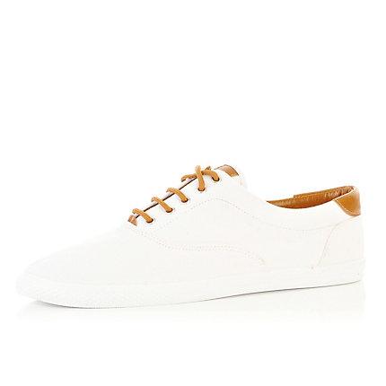 White and tan contrast plimsolls