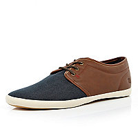 Blue denim and brown plimsolls