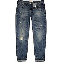 Mid wash distressed Flynn skinny jeans