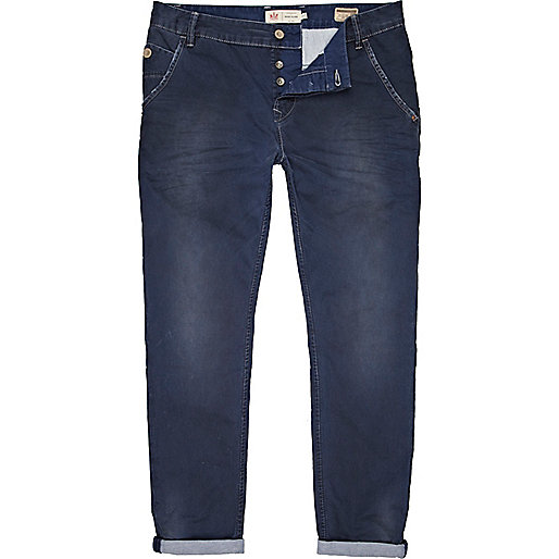 Blue distressed rolled up slim chinos