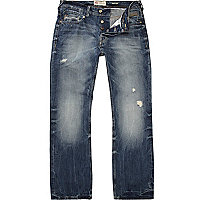 Mid wash distressed Clint bootcut jeans