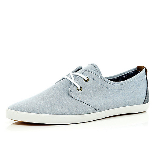 Blue lace up plimsolls