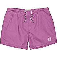 Bright purple swim shorts