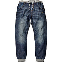 Mid wash distressed Ryan jogger jeans