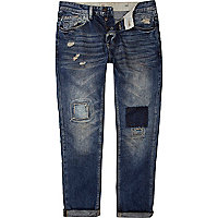 Mid wash distressed Dylan slim jeans