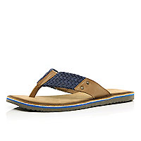 Blue and tan plaited flip flops