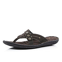 Brown cross over studded flip flops