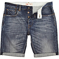 Mid wash distressed turn up denim shorts
