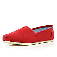 Red slip on plimsolls