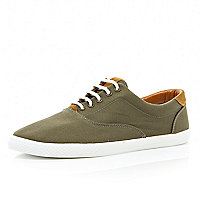 Green canvas lace up trainers