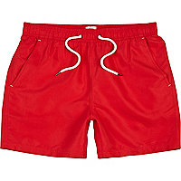 Bright red mid length swim shorts
