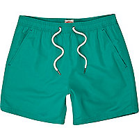 Bright green swim shorts