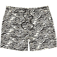 Black zebra print swim shorts