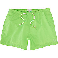 Neon green swim shorts