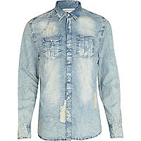 Blue light wash distressed denim shirt