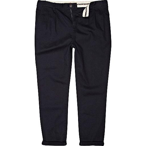 Navy pleat waist carrot trousers
