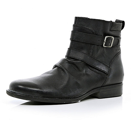 Black distressed strap biker boots