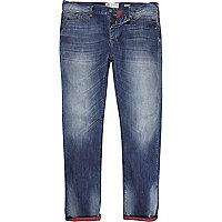 Mid wash Flynn skinny jeans