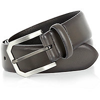 Grey metal buckle belt