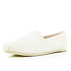 White slip on plimsolls