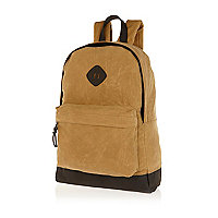 Light brown waxed canvas backpack