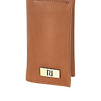 Light brown fold over card holder