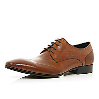 Brown perforated wingtip lace up shoes