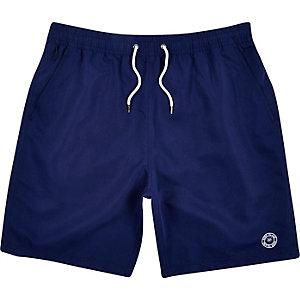 Navy blue mid length swim trunks