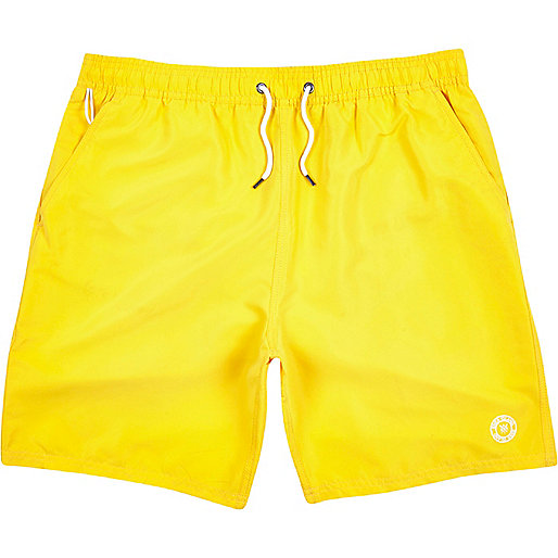Bright yellow mid length swim shorts