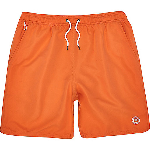 Bright orange mid length swim shorts