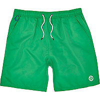 Bright green mid length swim shorts