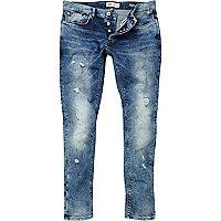 Mid wash ripped Eddy skinny stretch jeans