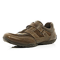 Brown strap fastened trainers