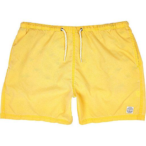 Yellow short swim trunks