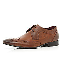 Brown pointed wingtip brogues