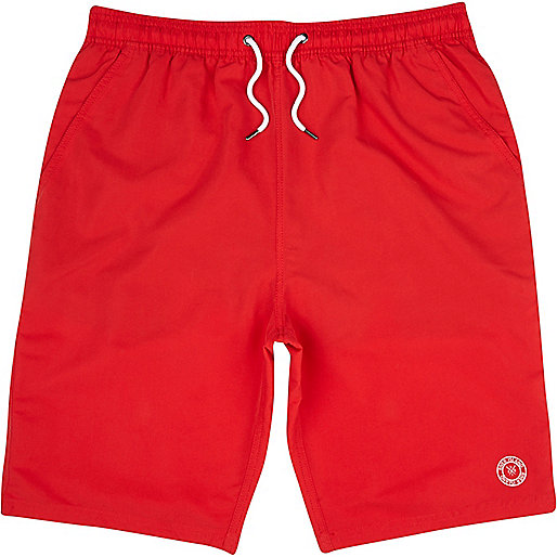 Bright red long swim shorts
