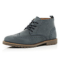 Blue cleated sole brogue boots