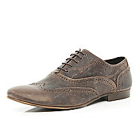 Brown distressed wingtip brogues