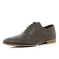Brown waxy brogues