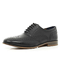 Black lace up wingtip brogues