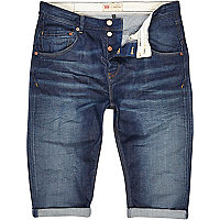 Mid wash distressed long denim shorts