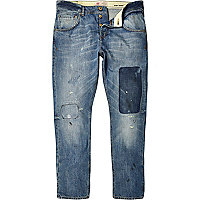 Mid wash distressed Chester tapered jeans