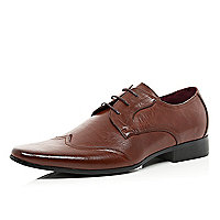 Brown wingtip formal shoes