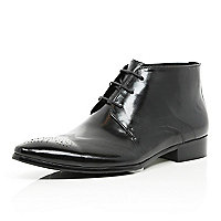 Black perforated wingtip lace up boots