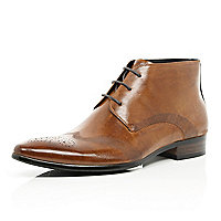 Tan perforated wingtip lace up boots